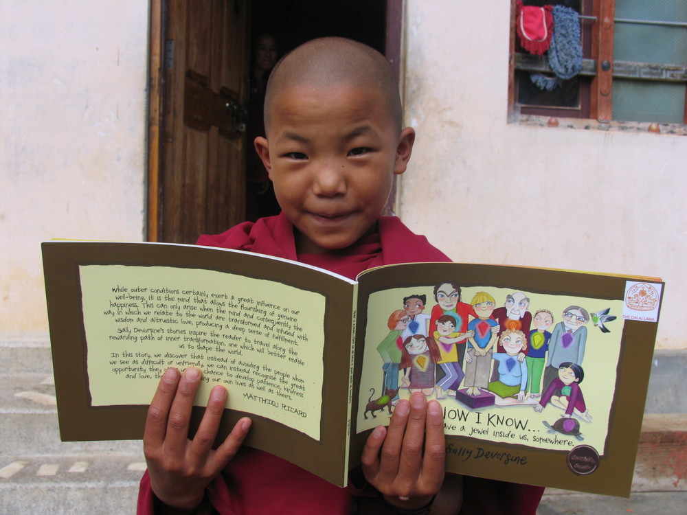 A nun at the Sissinang Nunnery in Bhutan enjoying one of the NOW I KNOW books.
