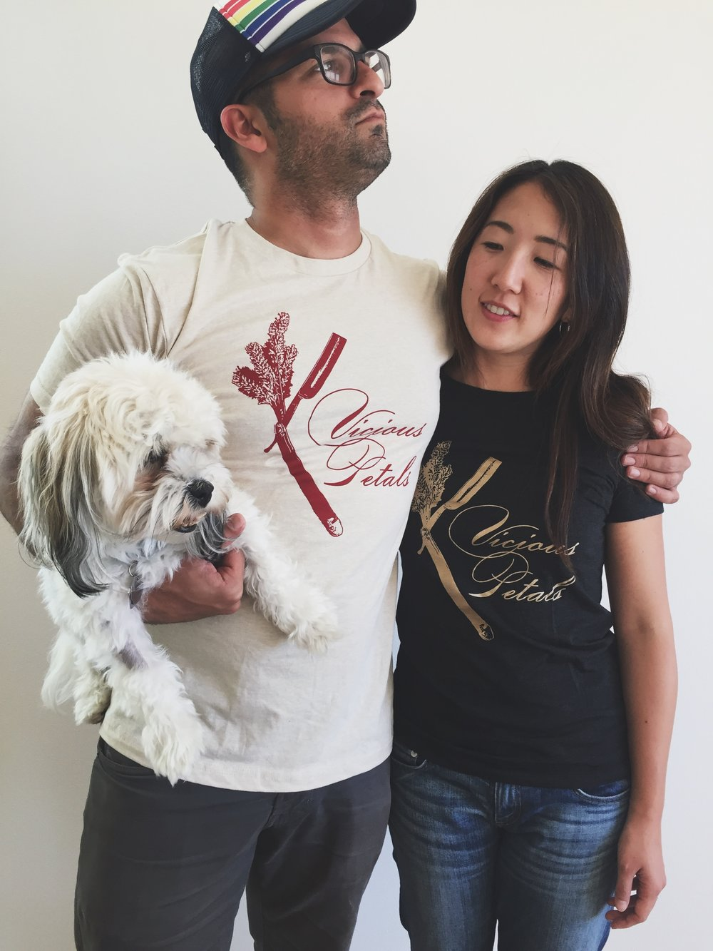 Yoko and Ravi stylin' in our new Ts. Be like these cool kids and grab one this Saturday at the Tractor! (Fluffy pup not included.)