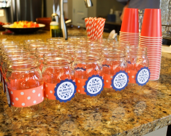 Mason jars wrapped with ribbon and a customized label - one of our favorite tricks for making a party feel unique and chic!