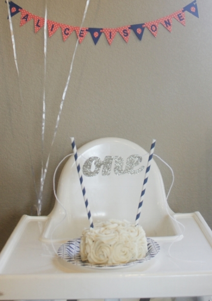 "A custom mini banner, gorgeous smash cake from  The Petite Cakery , and a gold glitter ""one"" cake topper attached to some navy straws...what more could the birthday girl ask for??"