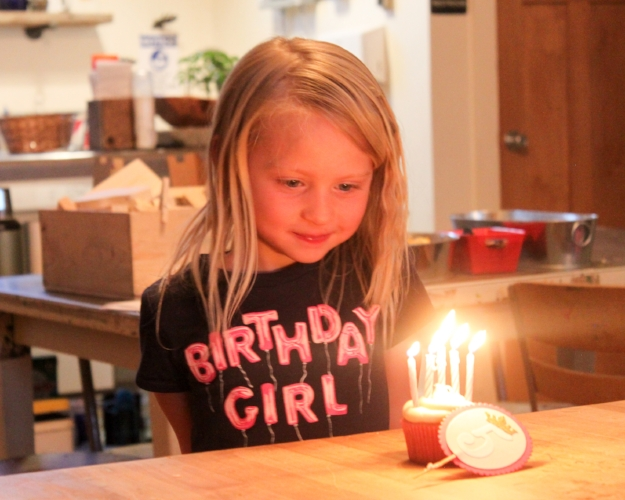 The birthday girl illuminated by her 5(!) candles! Next year we'll need bigger cupcakes for these kids and all their candles!
