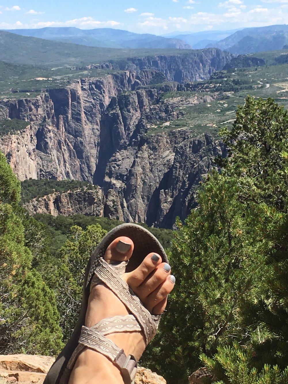 Hello foot in front of pretty landscape photo. I'm original.