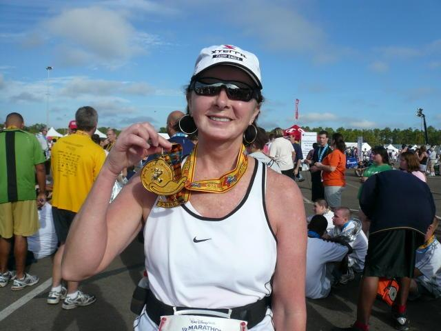 Sandi is very proud (and rightfully so!) to show her Donald Duck medal after completing the Walt Disney World Half Marathon (2008-01-12)