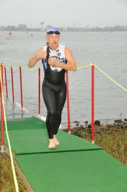 "In April 2008, Richard competed in the LoneStar Half Ironman. For those of you not ""in-the-know,"" that's a 1.2 mile swim, 56 mile bike, and 13.1 mile run! Here's Richard finishing the swim portion. (2008-04)"