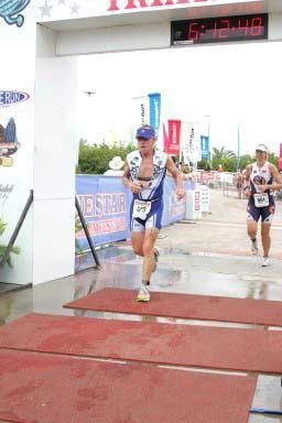70.3 miles of sheer endurance later, Richard crossed the finish line with a time of about 5 hours. (The clock above his head is for the sprint distance that took place earlier in the day). (2008-04)
