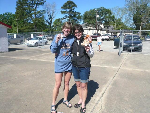 Mary and Sandi ran in the Davy Crockett Bear Chase Half Marathon (13.1 miles) in April. It was Mary's first half marathon. Sandi finished and dropped 26 miles off her time. Here they're showing off their medals and stuffed bears. (2008-04-12)