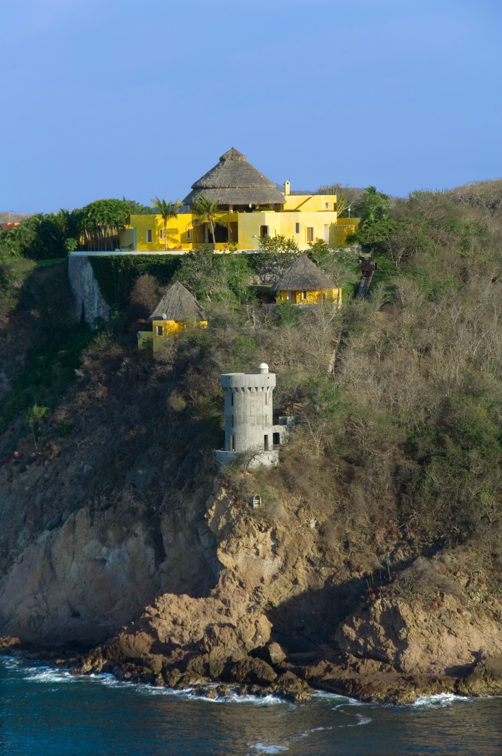 Costa Careyes.Castle.SoldeOriente.Exterior Set into the Cliffs.jpg