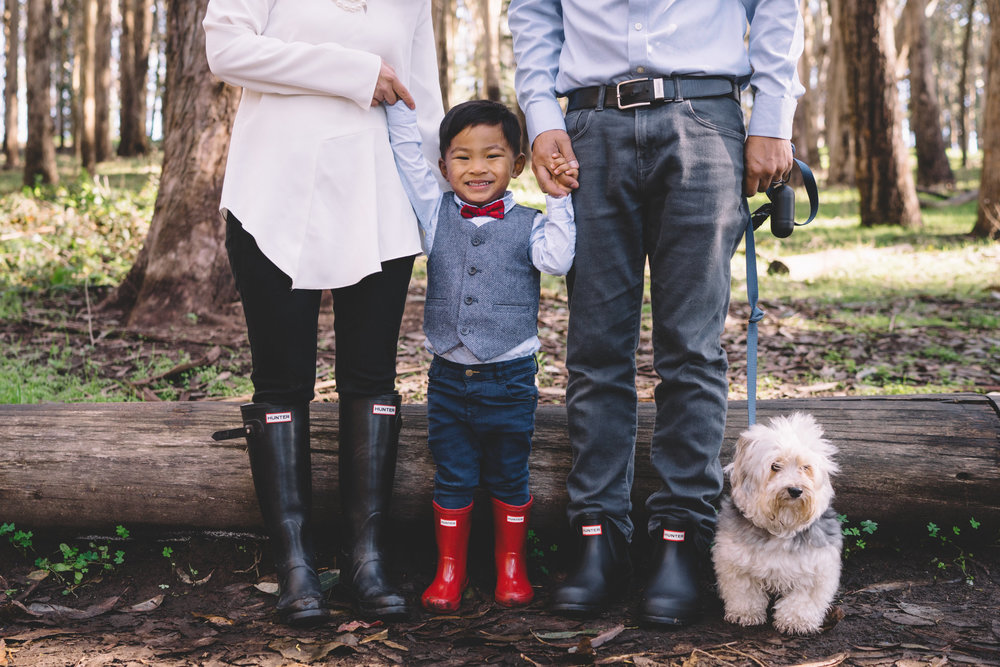 Hunter boots. Your eye is drawn to the red bowtie and matching red boots on Hudson. Perfect.