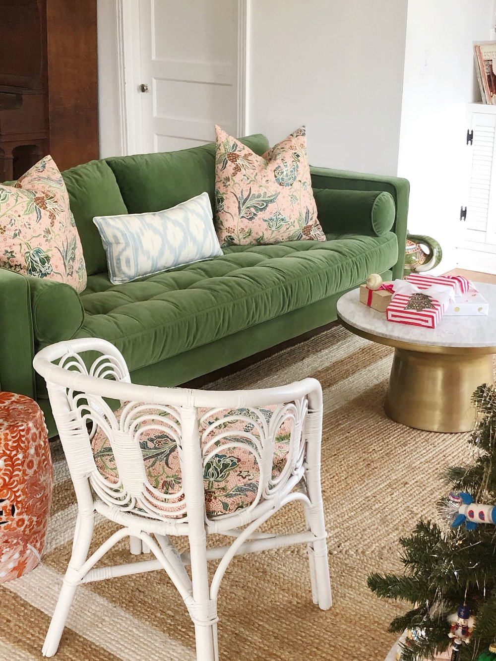 brass coffee table ,  sisal rug ,  ikat pillow ,  gift wrapping