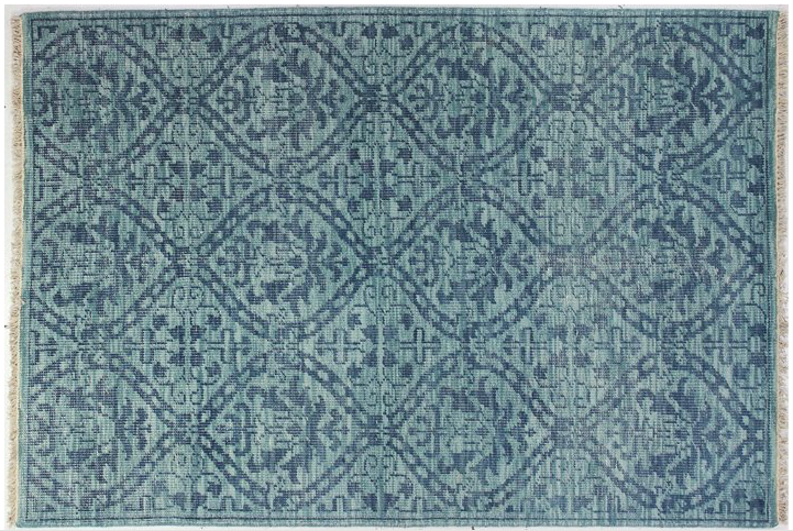 this  hand knotted wool rug  is a beauty. see more our our  favorite rugs here !