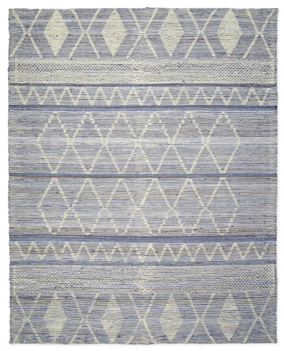 we love this  denim rug  of tonal blues and white
