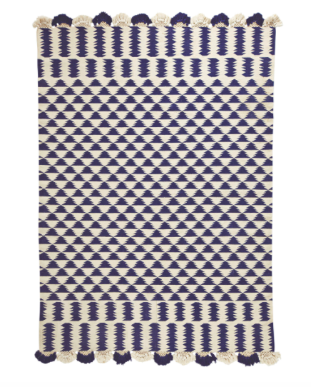 this  fun fringed geometric rug  is on sale for under $100!