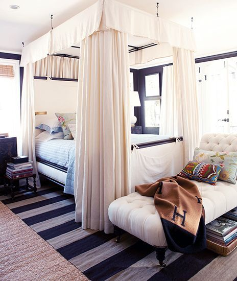mark d. sikes' bedroom / get the look with this  striped rug  layered on top of this  natural rug