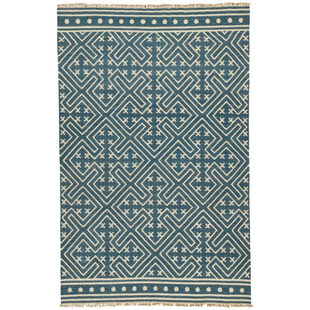 it's no surprise we love  blue and white  and are swooning over this  geometric rug