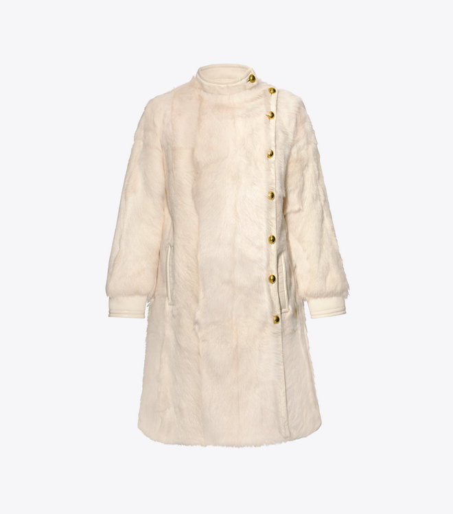 we adore this  coat  with its off center dome buttons