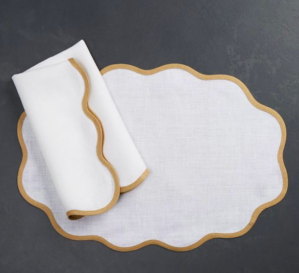 these darling  scalloped table linens  are a must for any tabletop!