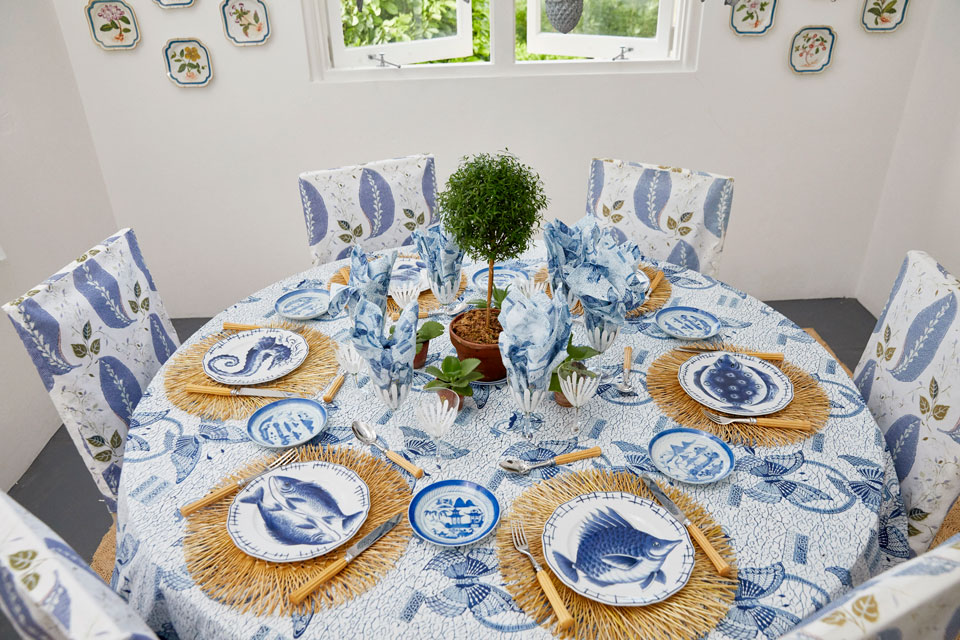 photo: tory burch / get the look:  raffia placemats ,  butterfly tablecloth ,  fish dinner plates