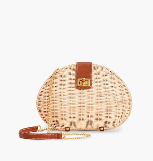 this versatile  wicker clutch  is at the tippy top of our wishlist!