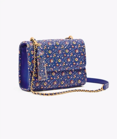 add a pop of color to any outfit with this  floral printed handbag !