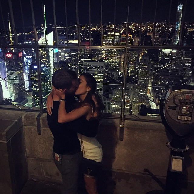 Romantic kiss on top of the Empire State Building