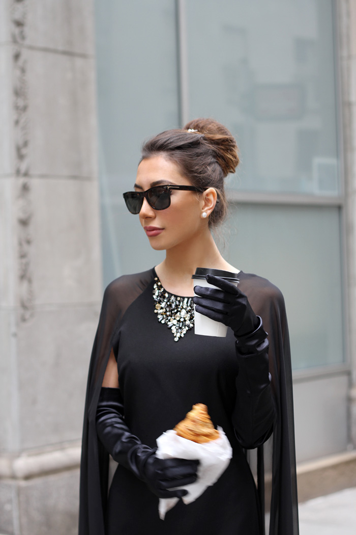 Audrey Hepburn look with croissant and coffee. Black gown