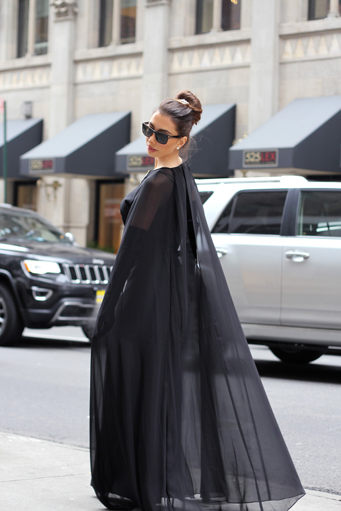 Black cape dress worn by Ulia Ali for Audrey Hepburn week