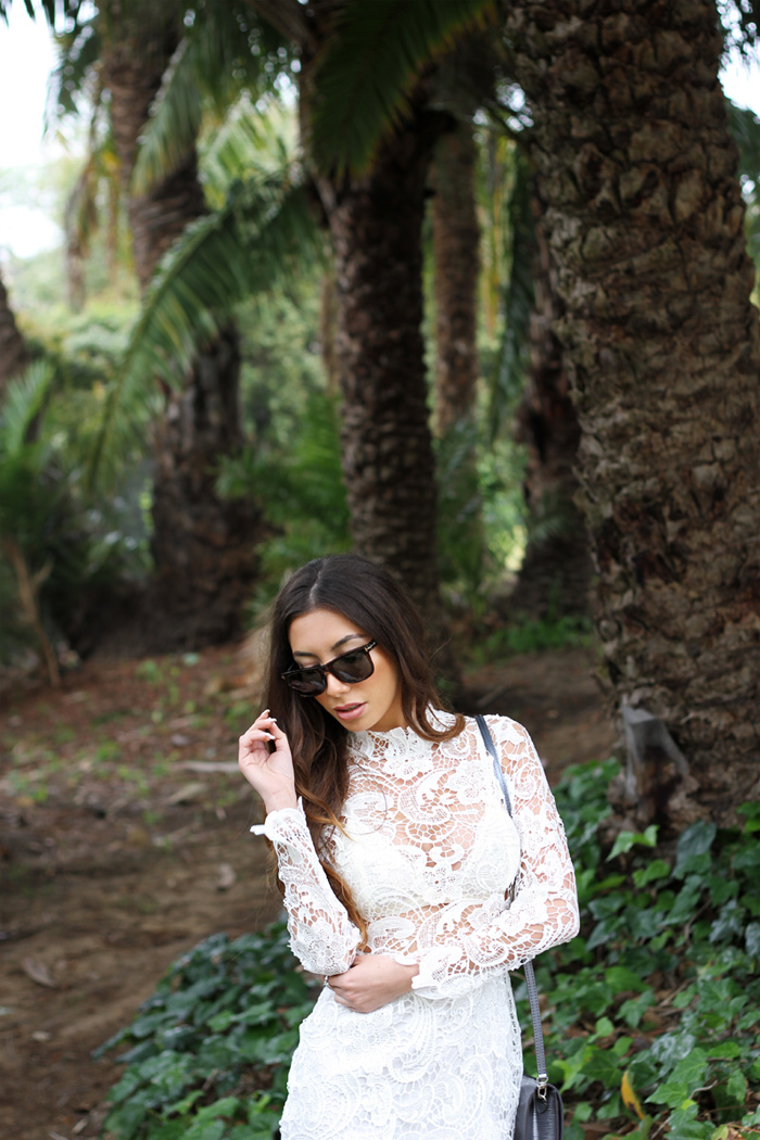 Fashion blogger Ulia Ali wearing NAsty Gal white lace dress in Santa Barbara, California