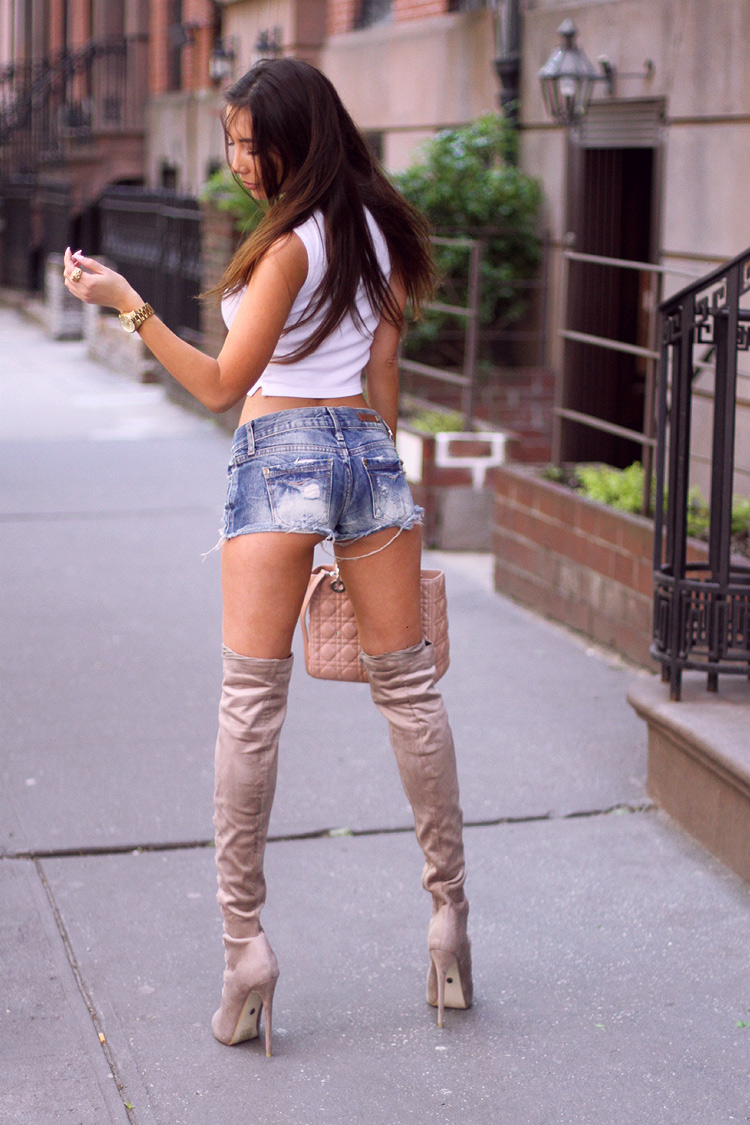Sexiest look in NYC. Over the knee lace up boots and denim shorts