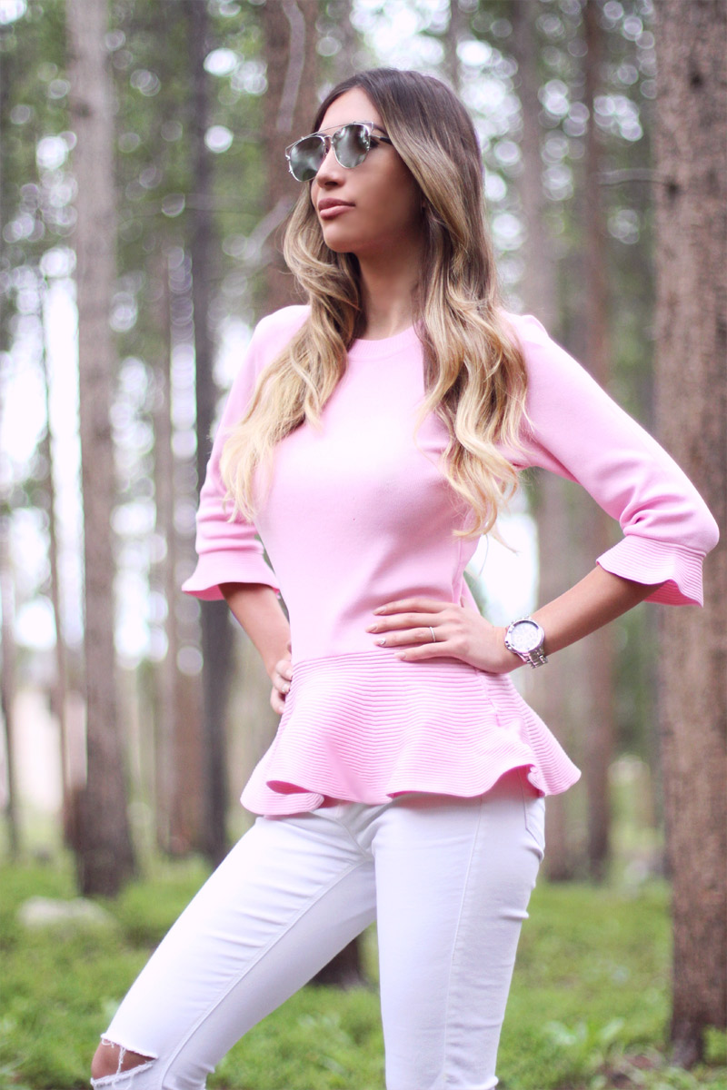 Dior sunglasses and pink peplum top.
