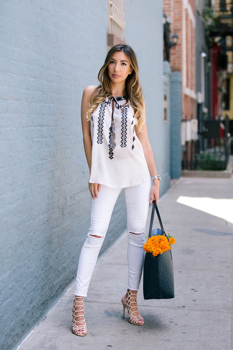Ulia Ali in Walter Baker, Slithur heels by Steve Madden, Michael Kors Hayley tote bag and white Topshop jeans.