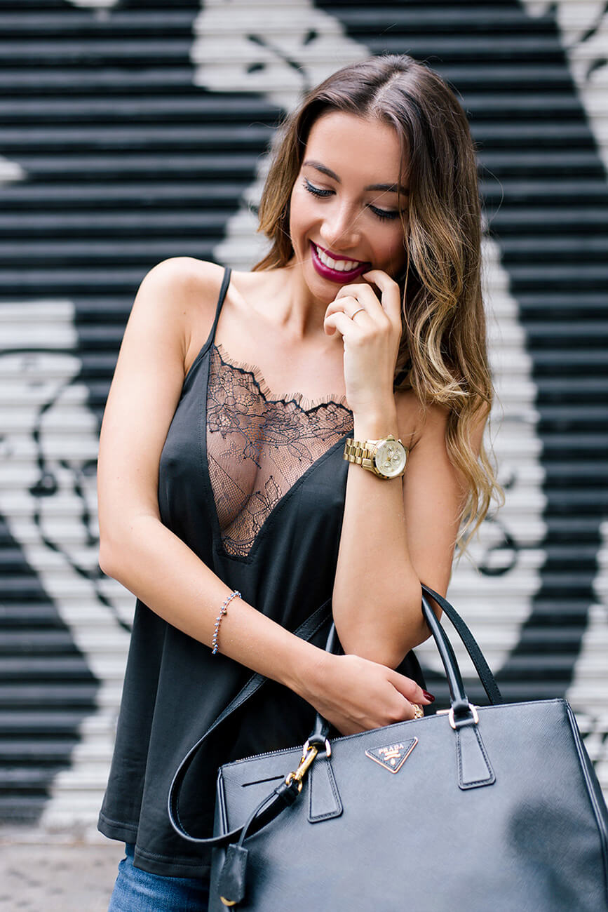 Prada Bag. Very sexy lingerie style top in black. Revealing cleavage blogger outfit.