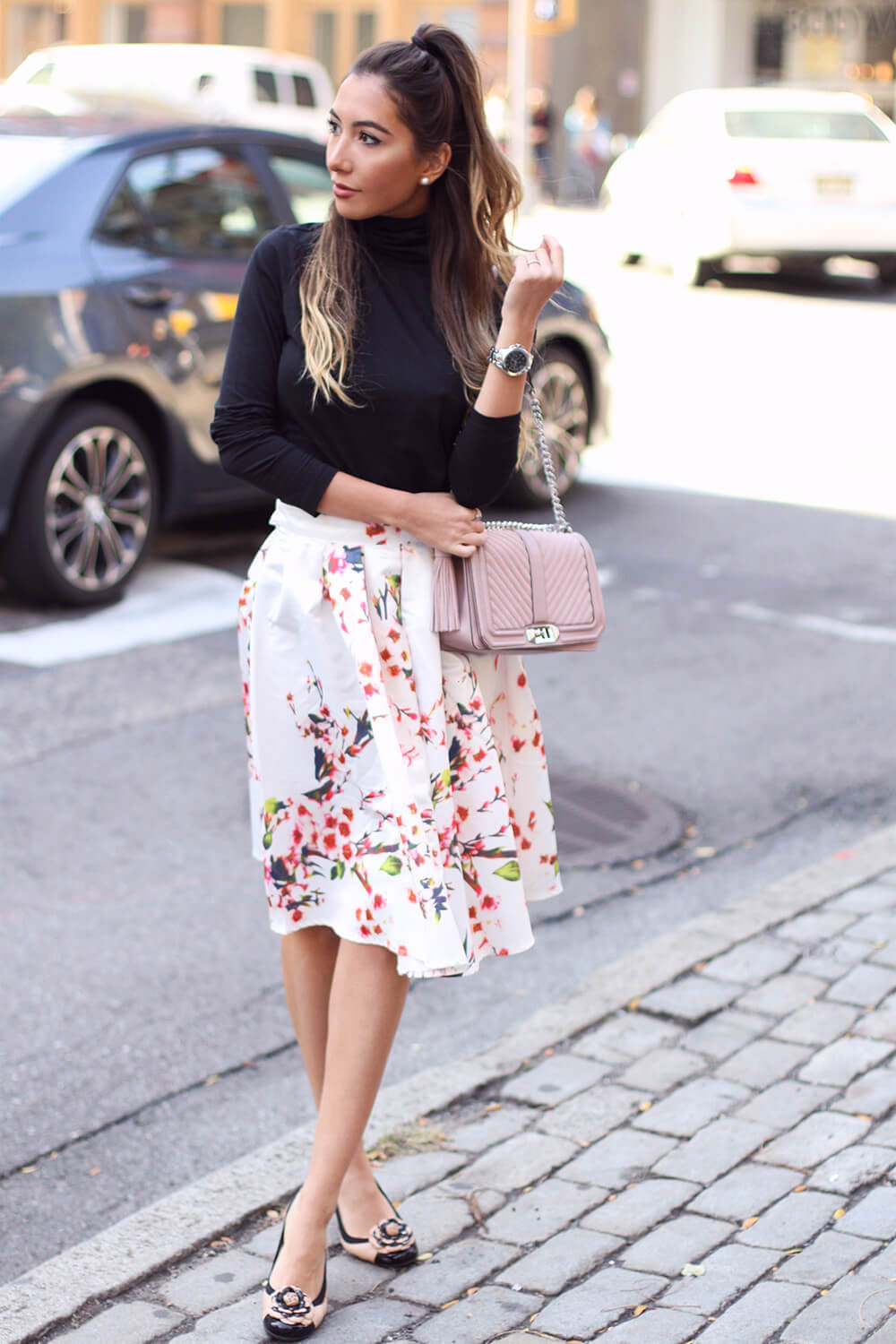 Floral skirt from Make Me Chic worn with black turtleneck. Style by Ulia Ali.