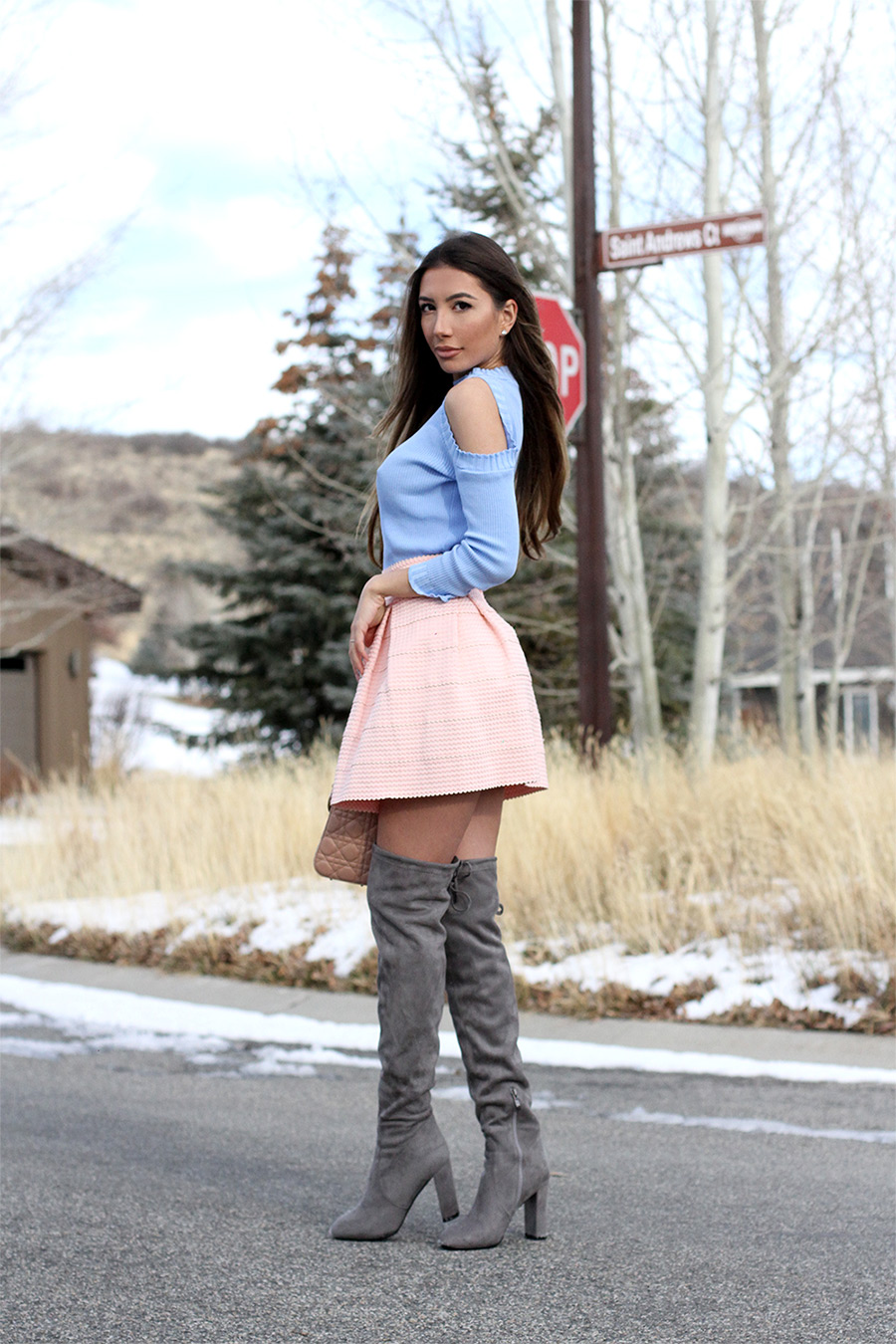 Blogger in pink and blue combo wearing Stuart Weitzman grey boots.