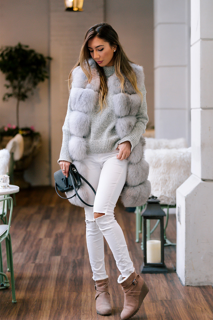 Street style New York, winter 2017. Winter cozy fur vest.