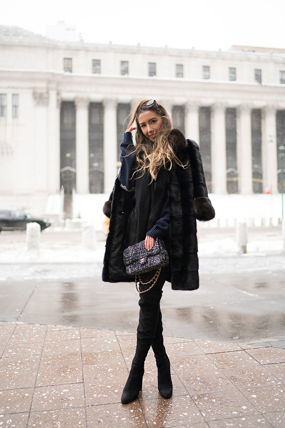 Style blogger during NYFW 2017 in black fur. 2018.