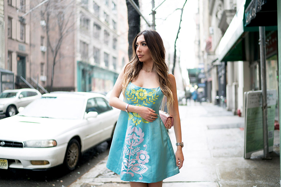 Blogger Ulia Ali in turquoise embroidered dress by Cynthia Rowley.