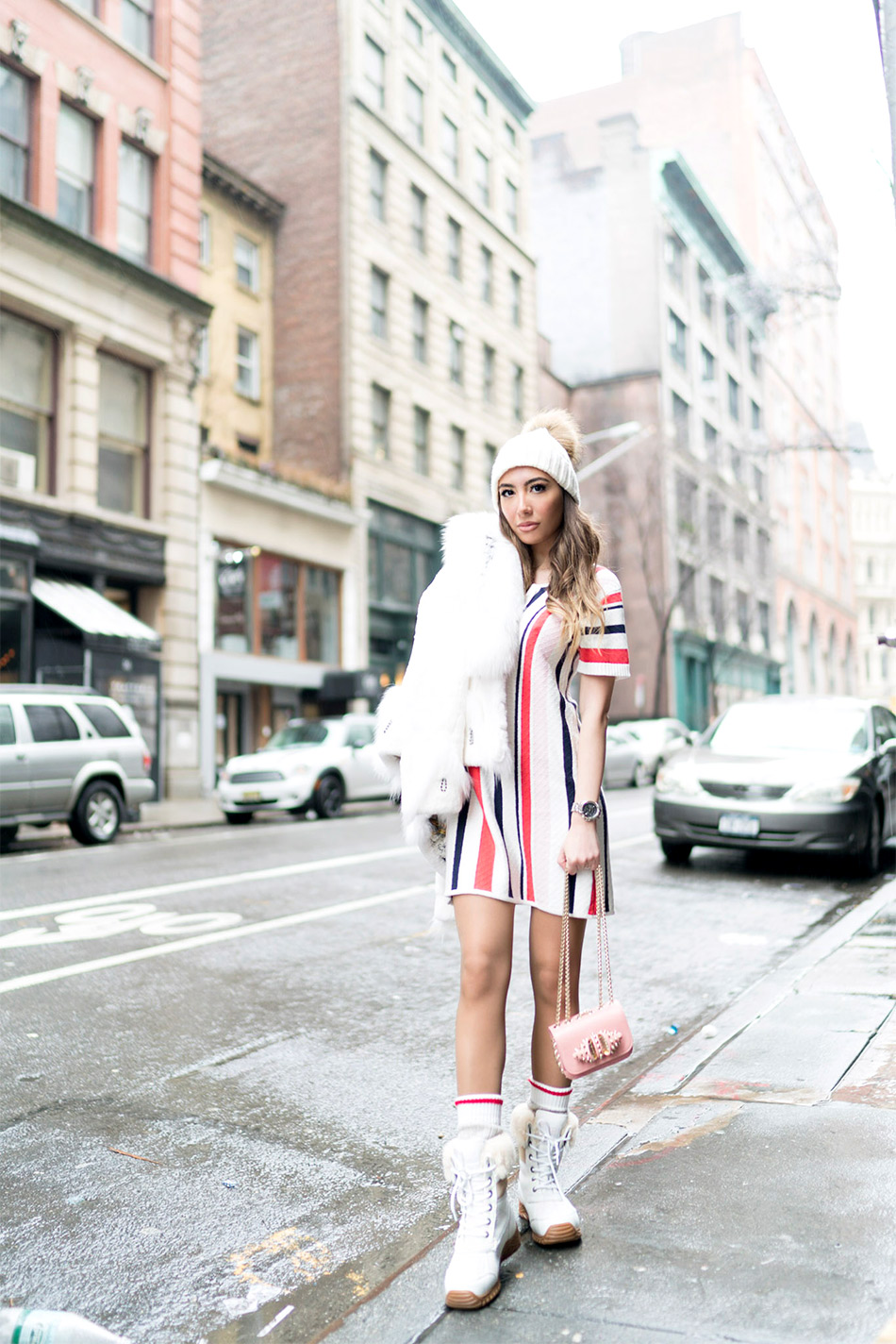 Ulia Ali in Tularose striped 70s dress from Revolve. UGG boots
