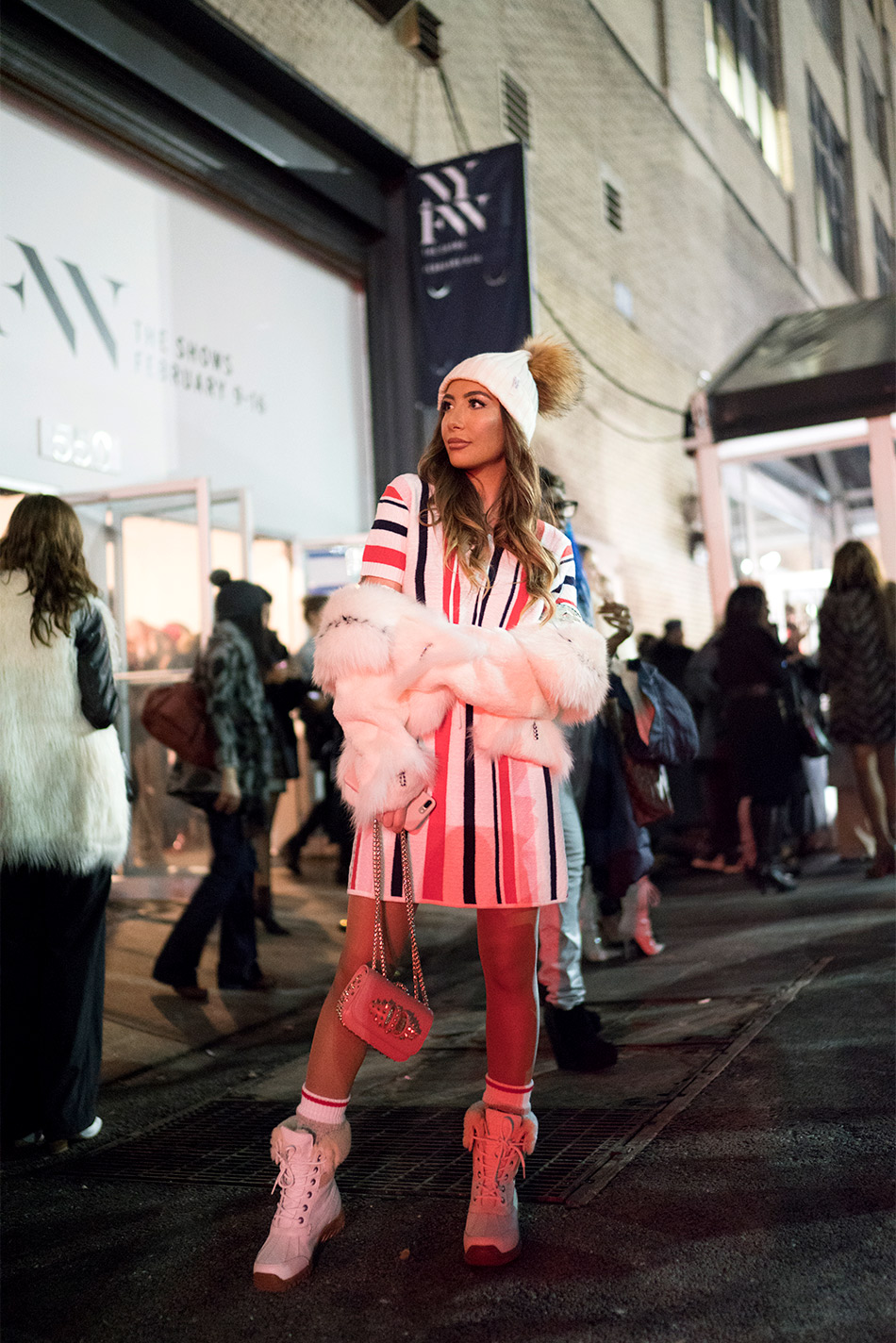 Ulia Ali in Tularose striped 70s dress from Revolve during NYFW.