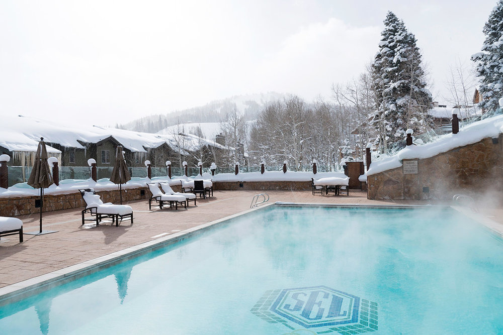 Heated pool in snowy mountains