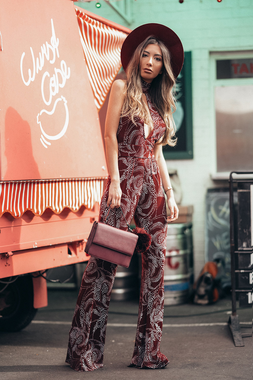 Fashionista Ulia Ali in New York wearing burgundy Clayton jumpsuit from REVOLVE.