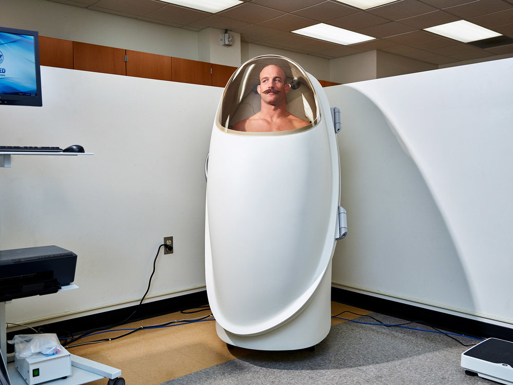 MMA fighter Patrick Durkin Cummins in a Bod Pod, which measures the percentage of fat and muscle