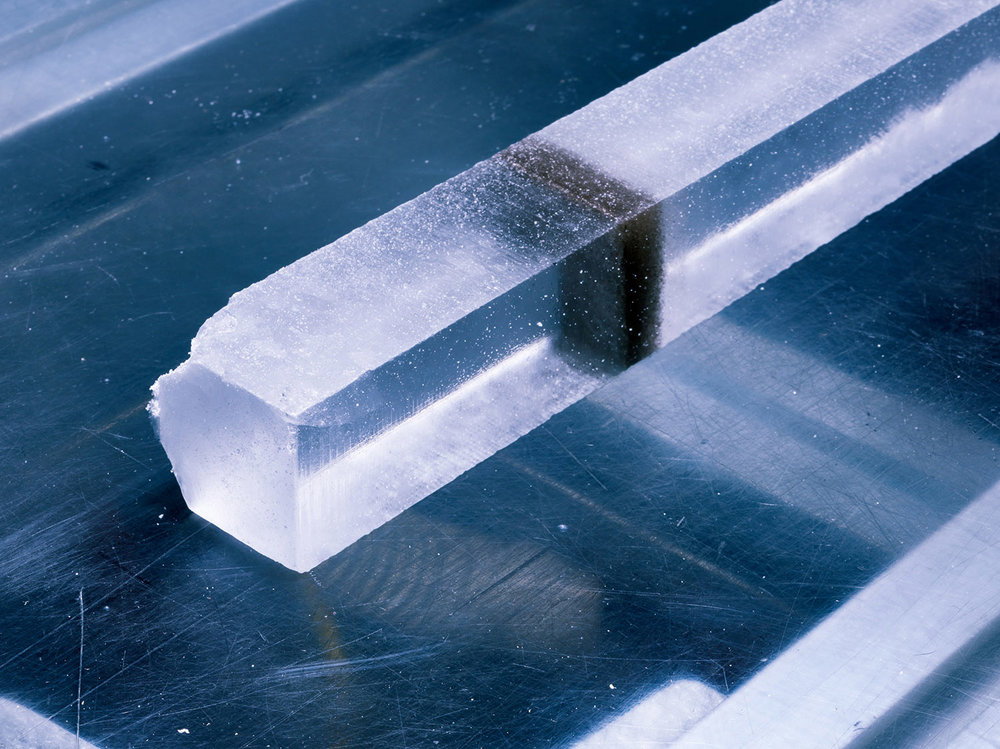 Processed ice core with bits of ash deposited by a volcanic eruption some 22,000 years ago