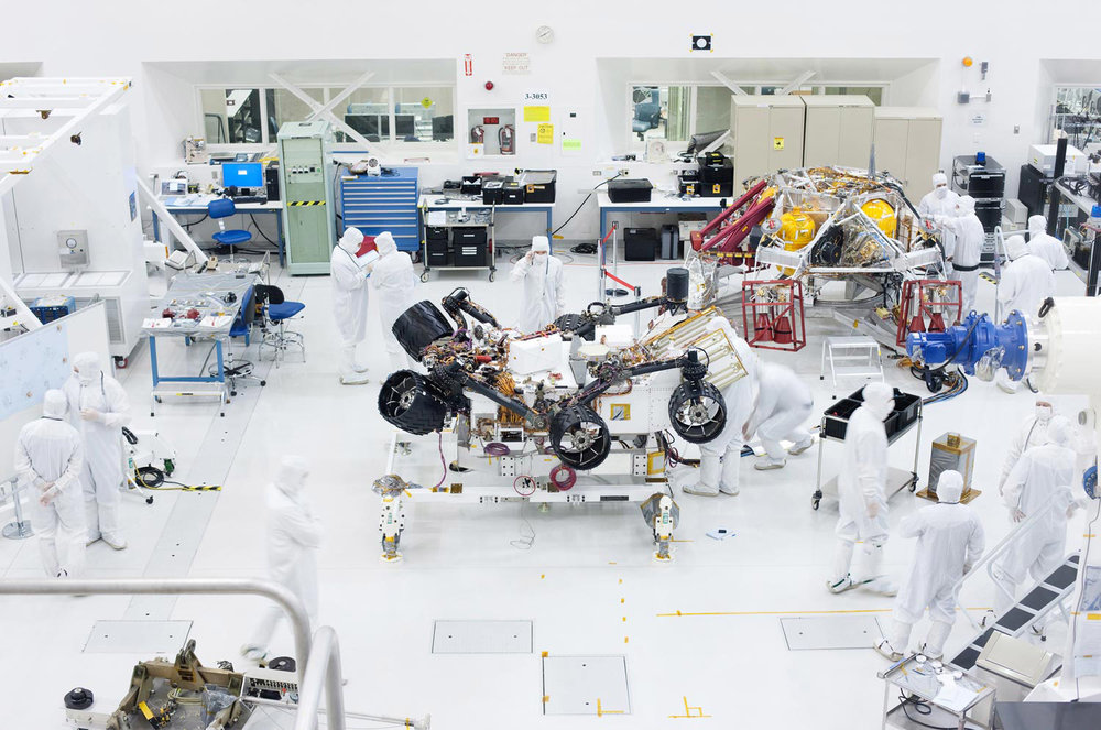 Scientists at JPL assembling Curiousity, the current Mars Rover