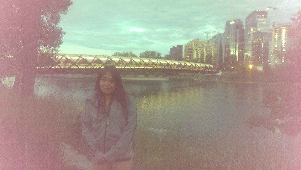 A grainy photo of me near the Peace Bridge, downtown Calgary, a year ago on Canada Day.