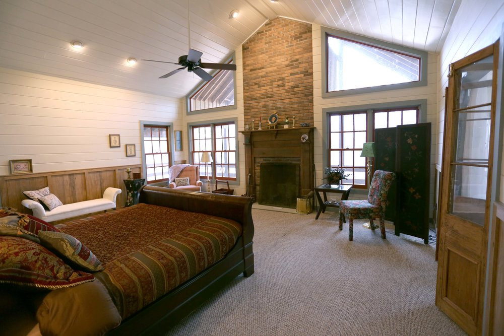 The Private Master Bedroom  in the LakeTrail House has a king bed. It has a private bathroom.