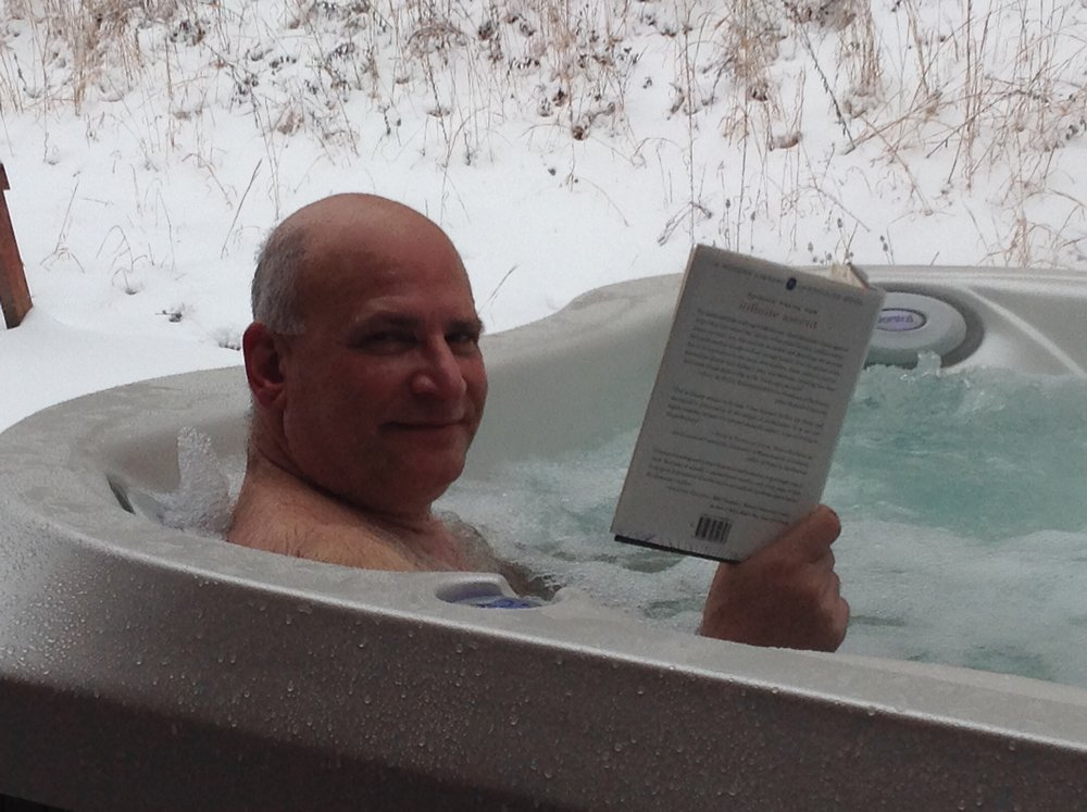 Reading in hottub.jpeg