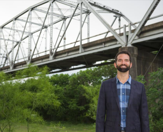 "Dale Glover of Rainey.Co, standing in front of the nostalgic Montopolis Bridge: ""I've looked closely  at the whole area and what would maximize the possibilities."""