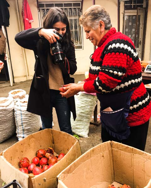 Anna M., one of our Tumo student friends, at work at the central market in Stepanakert shooting pomegranates.  Here's what she shot .
