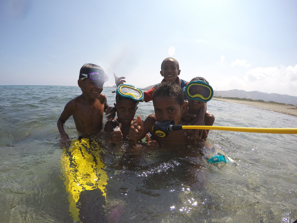 Kids playing at the Dili Rock. Photo: C. Heatherington