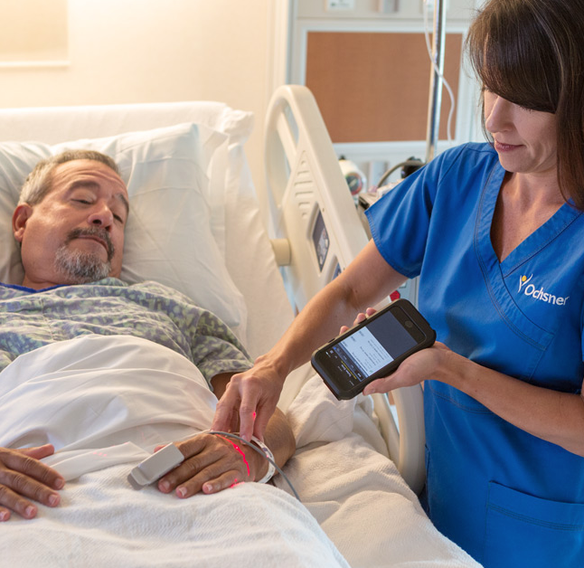 A nurse uses Epic Rover to scan and match barcode on medications to a patient wristband to ensure accurate prescription and dosage.
